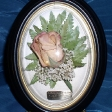 5x7-oval-boutonniere-display-on-easel